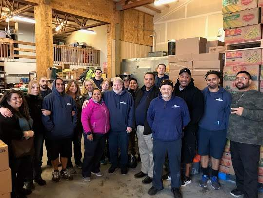 Group Photo of Apex Moving and Storage Staff in warehouse