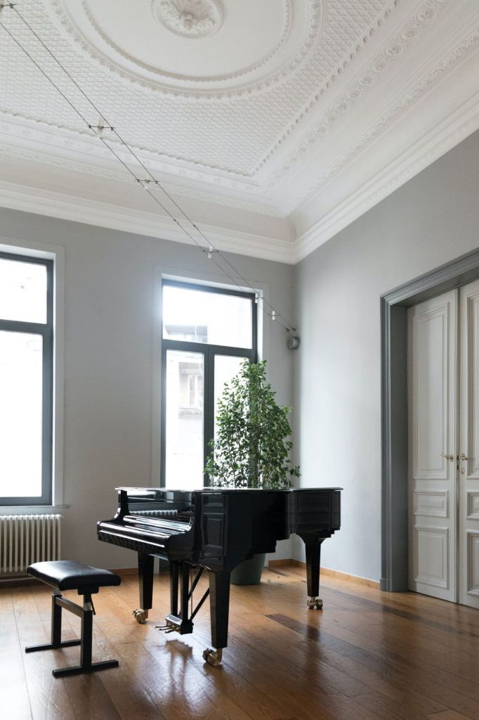 black grand piano in room